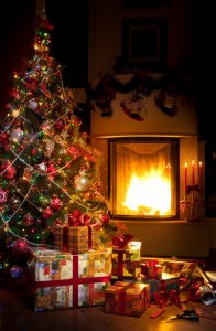 Christmas Tree and Christmas gift boxes in the interior with a fireplace